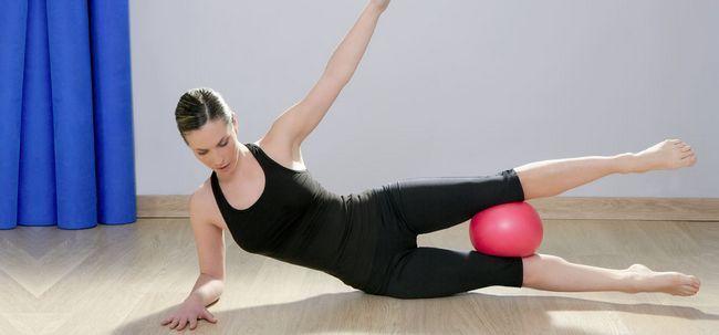 Top 10 Pilates-Übungen für Flat Abs Foto